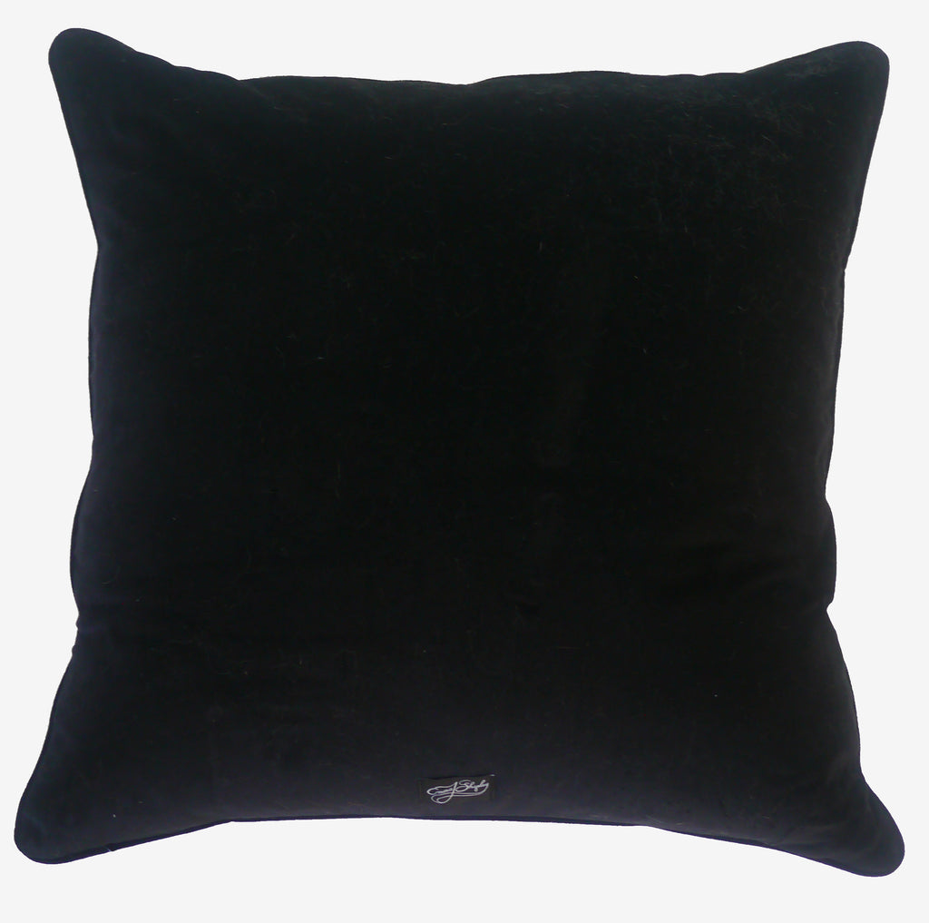 The luxurious black velvet backing of the Emma J Shipley Drakon Large Cushion, complete with a logo label at the bottom.