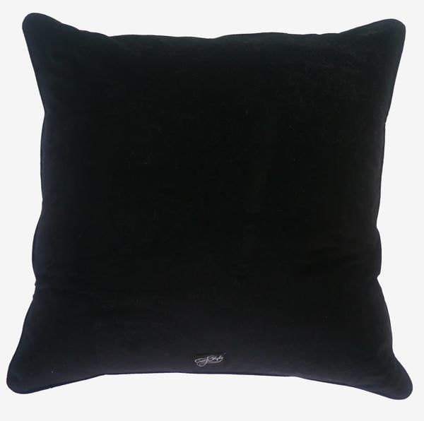 The luxurious black velvet backing of the Emma J Shipley Audubon Large Cushion, complete with a logo label at the bottom.