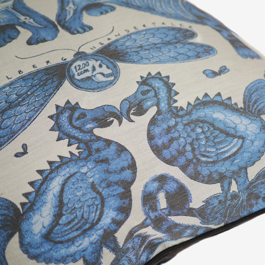 Two dodos which are hand-drawn and printed onto Emma J Shipley's Jacquard Woven Extinct cushion.