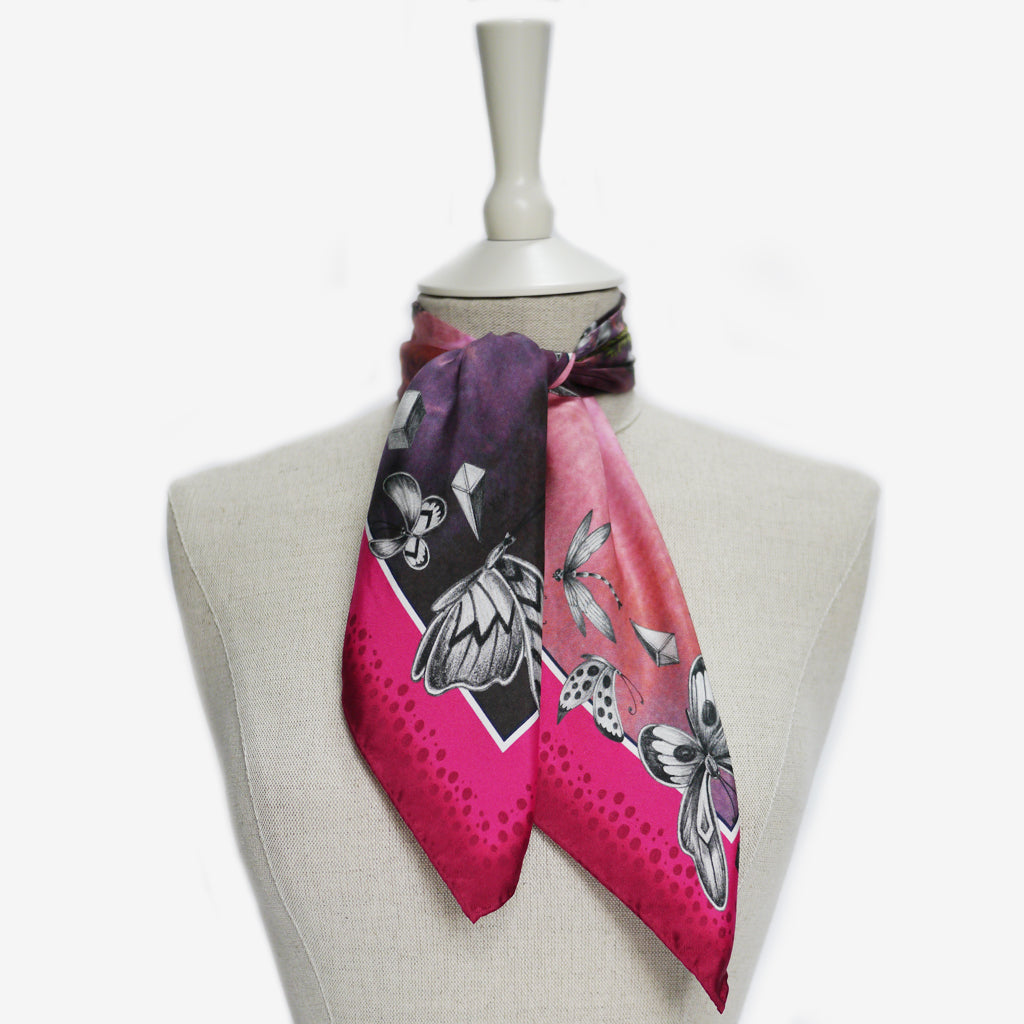 A tied example of the Giraffe Silk Neckerchief by Emma J Shipley, taken from the Heroes collection.