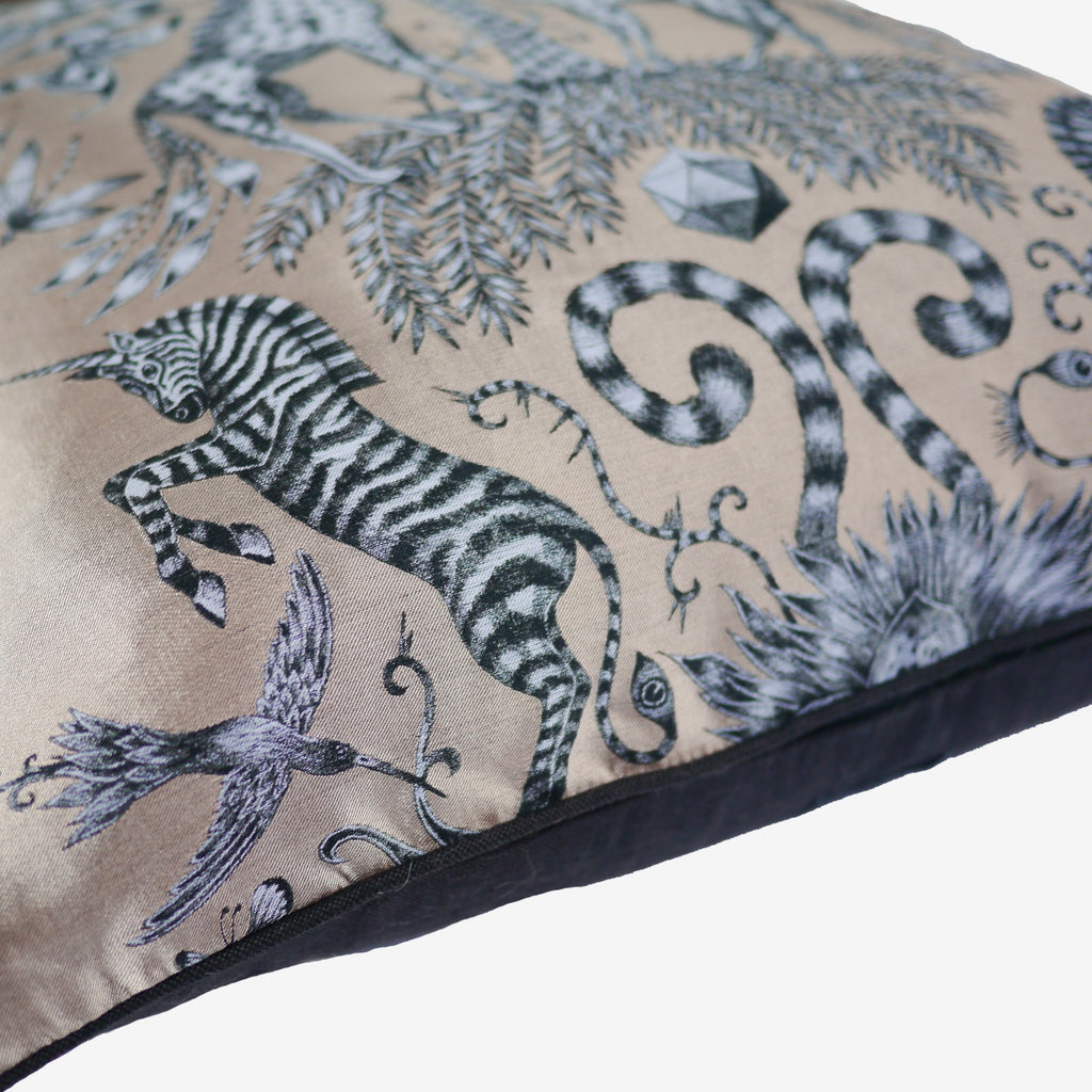 The hummingbirds and unicorn-zebras are printed onto the Jacquard Woven Gold Kruger Cushion, illustrated by Emma J Shipley