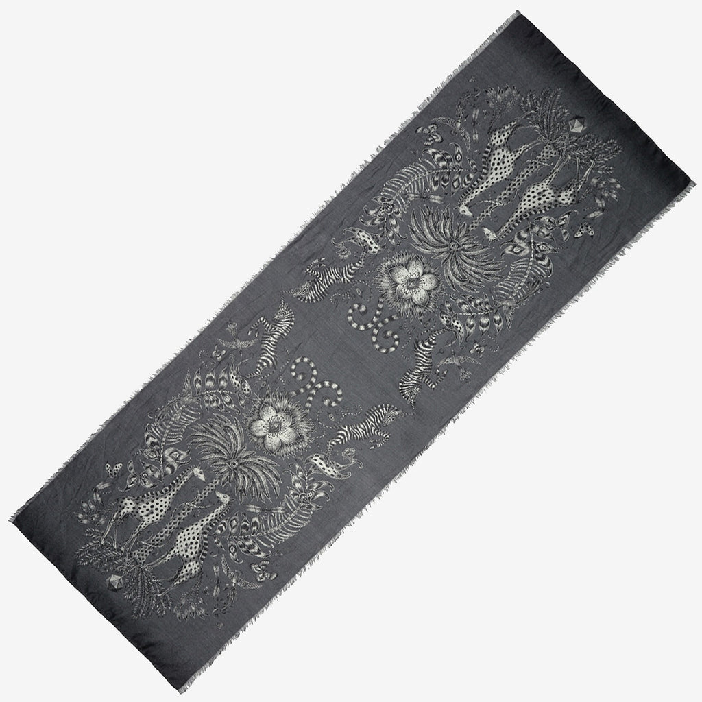 The Emma J Shipley Kruger Jacquard Woven scarf in grey is finished with an opulent eyelash fringed edge.