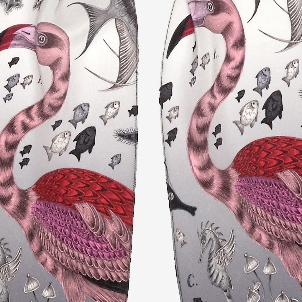 A detailed look at the Flamingo on the Grey Neptune Silk Skinny Scarf, surrounded by underwater creatures hand-drawn by Emma J Shipley on a silk chiffon scarf.