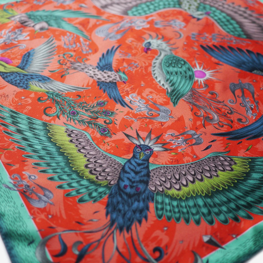 The scarf is adorned with an array of birds, soaring around the 60x60cm scarf.