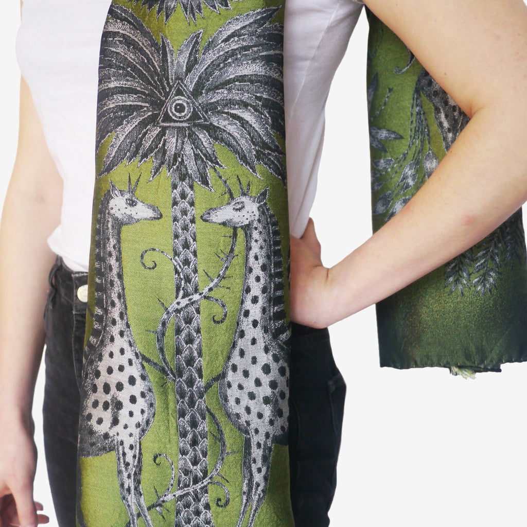 The Emma J Shipley Kruger Jacquard Woven scarf in lime is finished with an opulent eyelash fringed edge.