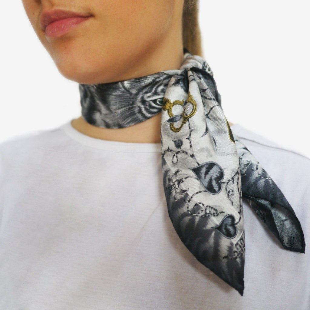 How to tie a silk neckerchief around the neck, by Emma J Shipley.