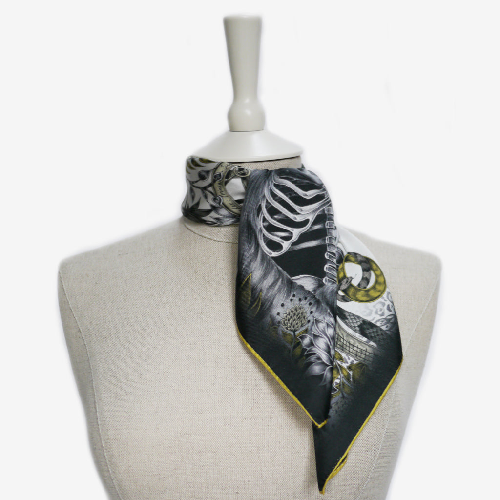 A tied example of the Silverback Silk Neckerchief by Emma J Shipley, taken from the Heroes collection.