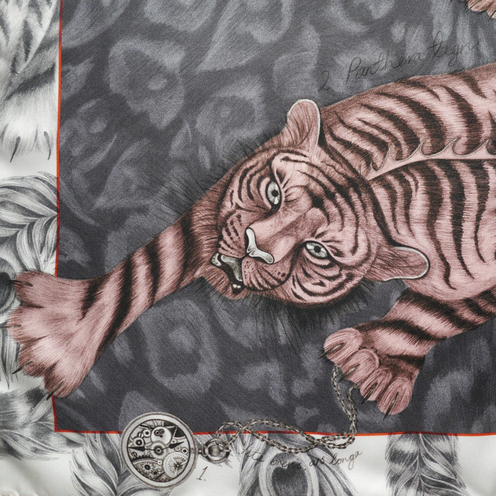 The hand-drawn pink tigris stands out beautifully against the grey silk scarf, by luxury designer Emma J Shipley.