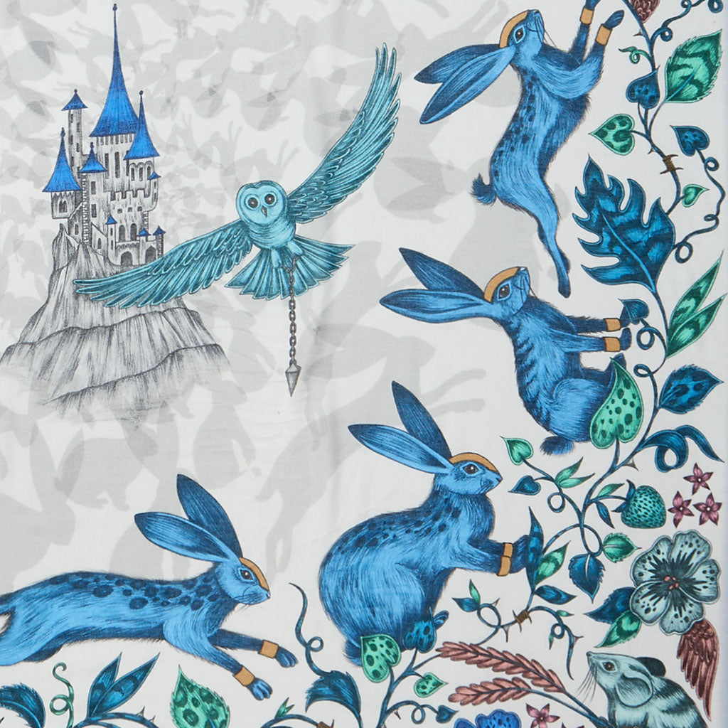 Spotted rabbits run around an enchanting castle in this design by Emma J Shipley
