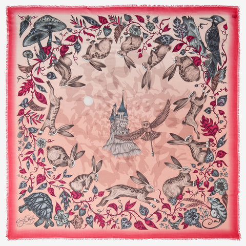 The luxurious modal blend scarf by Emma J Shipley featuring the pink Frith design is host to an imaginative scene of rabbits and a fairytale castle