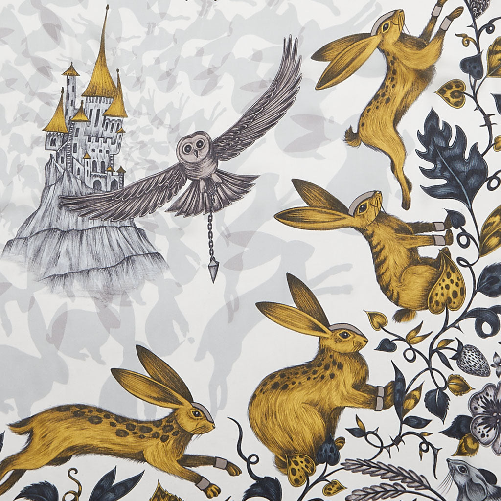 The luxuriously beautiful gold Frith Silk Chiffon Scarf designed by Emma J Shipley, featuring rabbits and a fairy-like enchanting castle