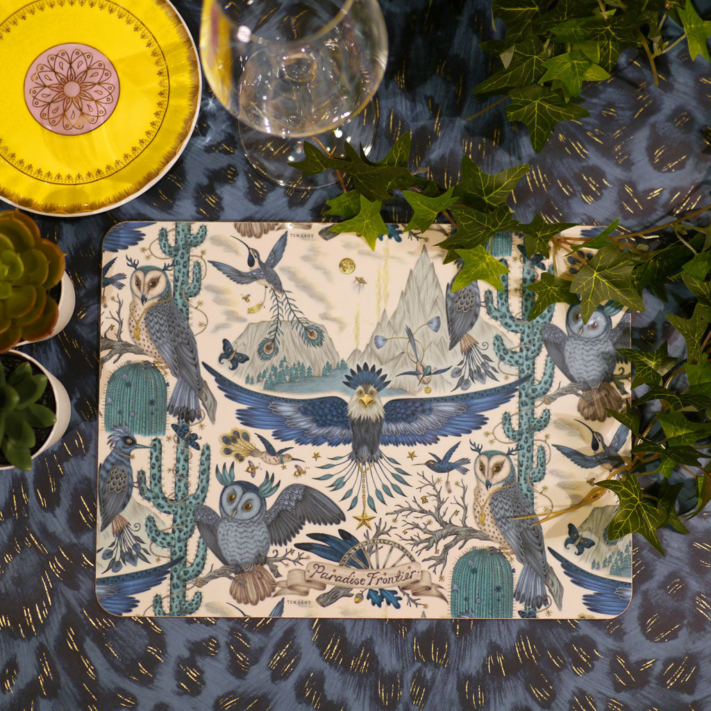 Emma J Shipley Frontier placemat or place mat in blue and navy colours, featuring an eagle, owls and cactus