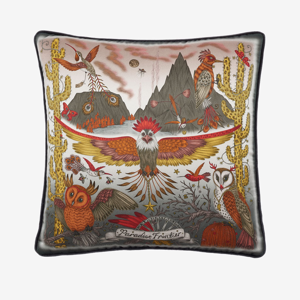 The Front of the Frontier cushion in orange showing the Wide spread American eagle, cactus and owls, designed by Emma J Shipley, this silk cushion is perfect to throw on your bed or to brighten up a chair or sofa