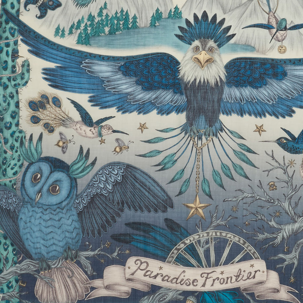 Detail of Emma J Shipley's blue Frontier fine wool scarf, featuring an eagle and owl.