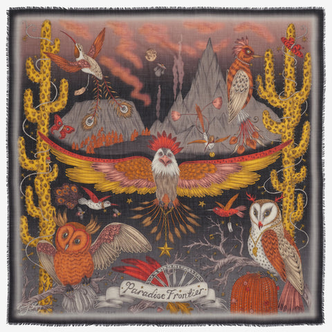 An Emma J Shipley Frontier wool scarf, made in Italy with a design featuring an eagle, owls, woodpeckers and hummingbirds. Nature inspired and in a warm colour palette or burnt oranges and golden yellows on a charcoal ground