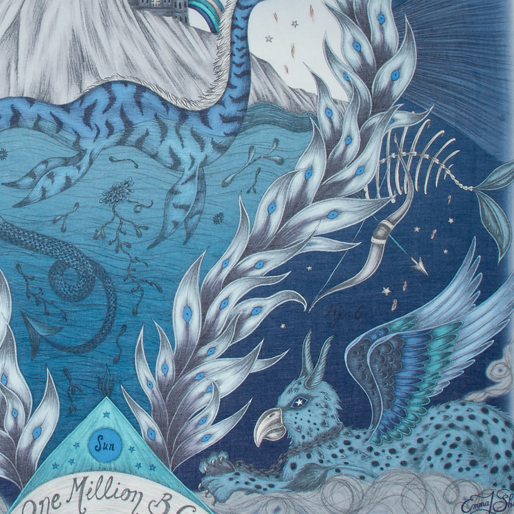 A detailed up close image of the Highlandia scarf in Blue, showing the detail of the little mythical creatures and animals.