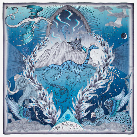 The SS20 Highlandia Silk Chiffons Scarf is the Scottish inspired landscape, in this beautiful rich blue tone, the print is really magical and shows off the Loch Ness monster, dragon and mammoth on this stunning silk. Designed by Emma J Shipley for the spring scarf collection