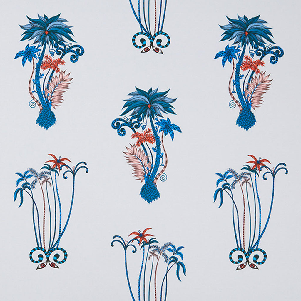 One of our more subtle designs, the exotic Jungle Palms cotton satin fabric designed by Emma J Shipley x Clarke & Clarke in blue will bring the tropics into your home