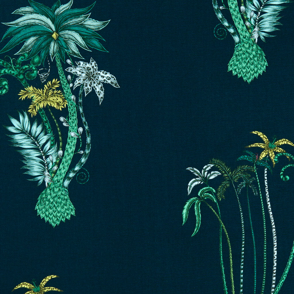 In navy which creates a sense of mystery, the exotic Jungle Palms cotton satin fabric designed by Emma J Shipley x Clarke & Clarke in navy