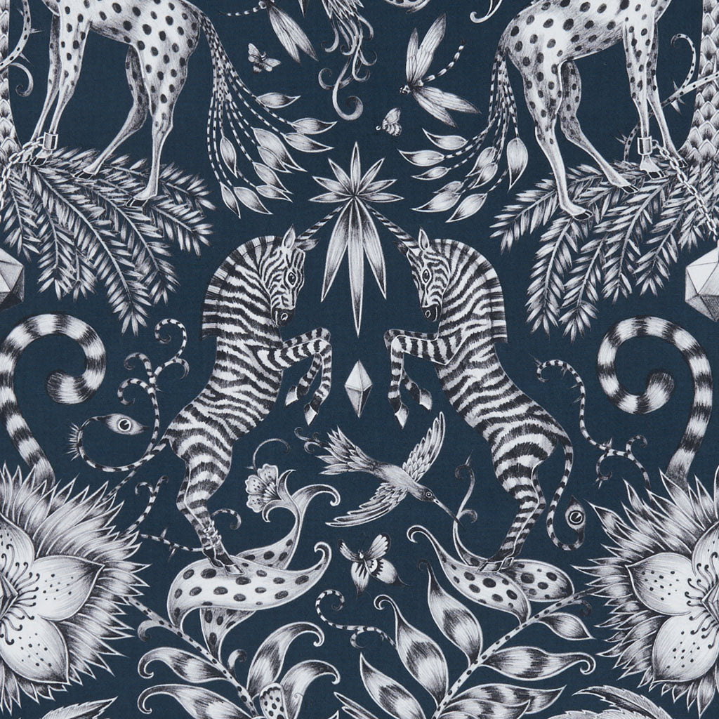 The enchanting navy Kruger cotton satin fabric designed by Emma J Shipley in collaboration with Clarke & Clarke will give a maximalist, luxury finish to your interior