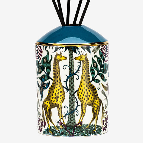 The Kruger Diffuser is a luxuriously designed and scented candle, with a scent of aromatic woods to coordinate with the intricate Kruger design. The Giraffes nested under a palm tree in the striking yellow are a magical centre piece for any hall table, bedside or bathroom - Designed by Emma J Shipley and scent created by Bahoma
