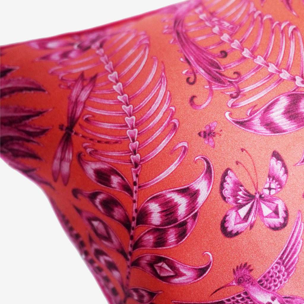 The vibrant orange and magenta colours on the Kruger Bolster Cushion make this accessory the perfect style statement.