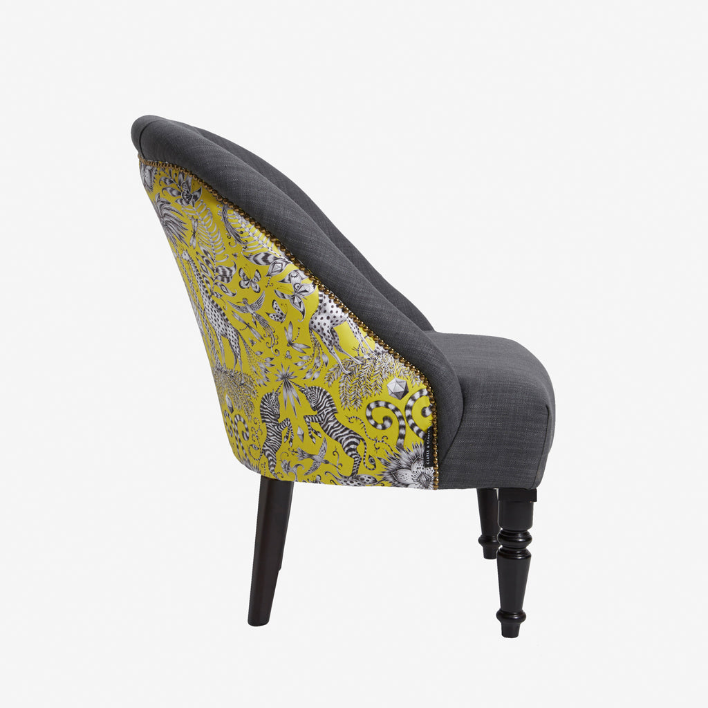 The Kruger Soho Chair is a striking mix of charcoal and lime on a statement chair made by Emma J Shipley with Clarke & Clarke