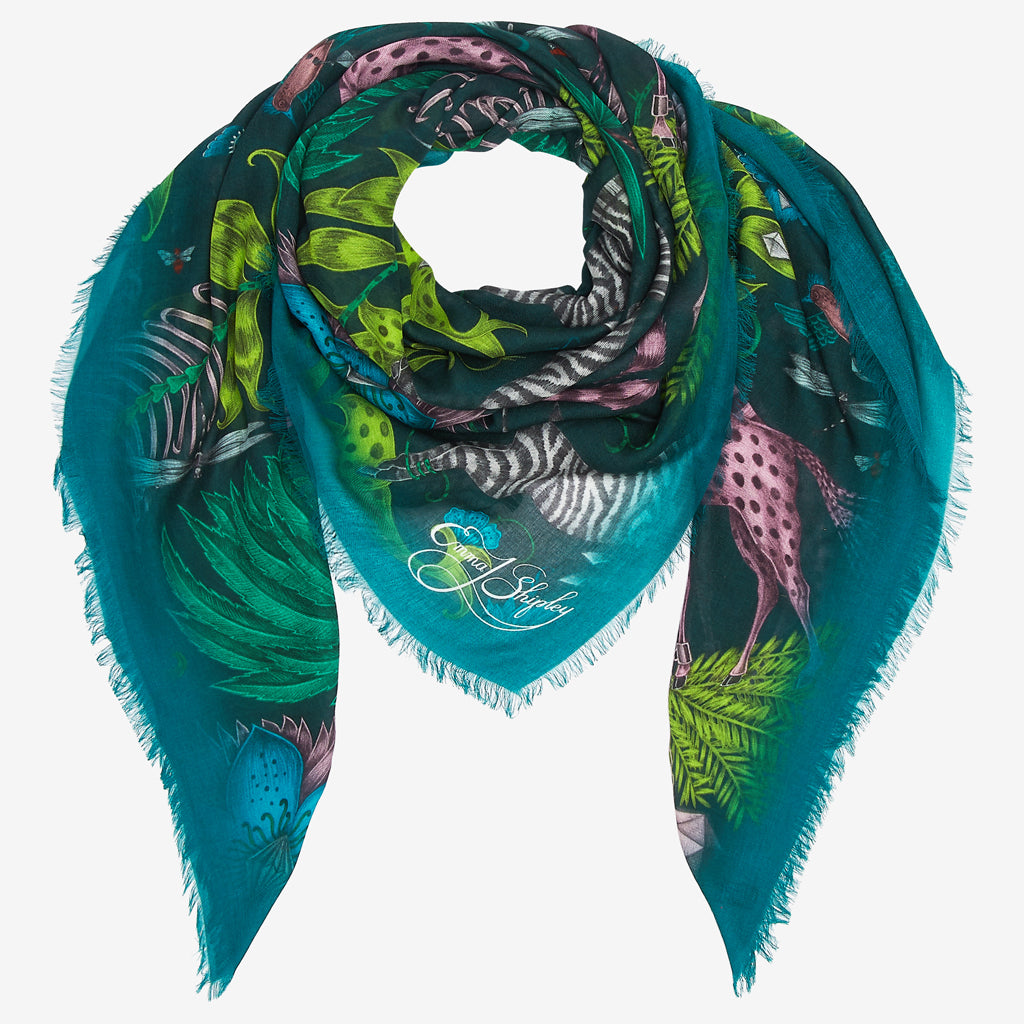 The Kruger Modal Blend Scarf in a dramatic deep teal background, echoing the African wildlife