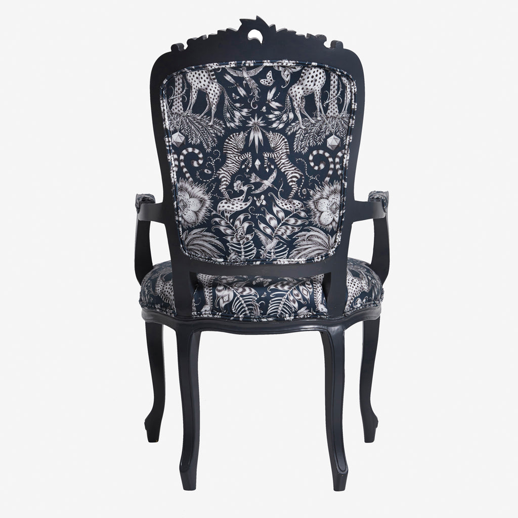 The Kruger Antoinette Chair displays the beautifully hand drawn Kruger design in cotton satin designed by Emma J Shipley for Clarke & Clarke. A decadent French dining chair