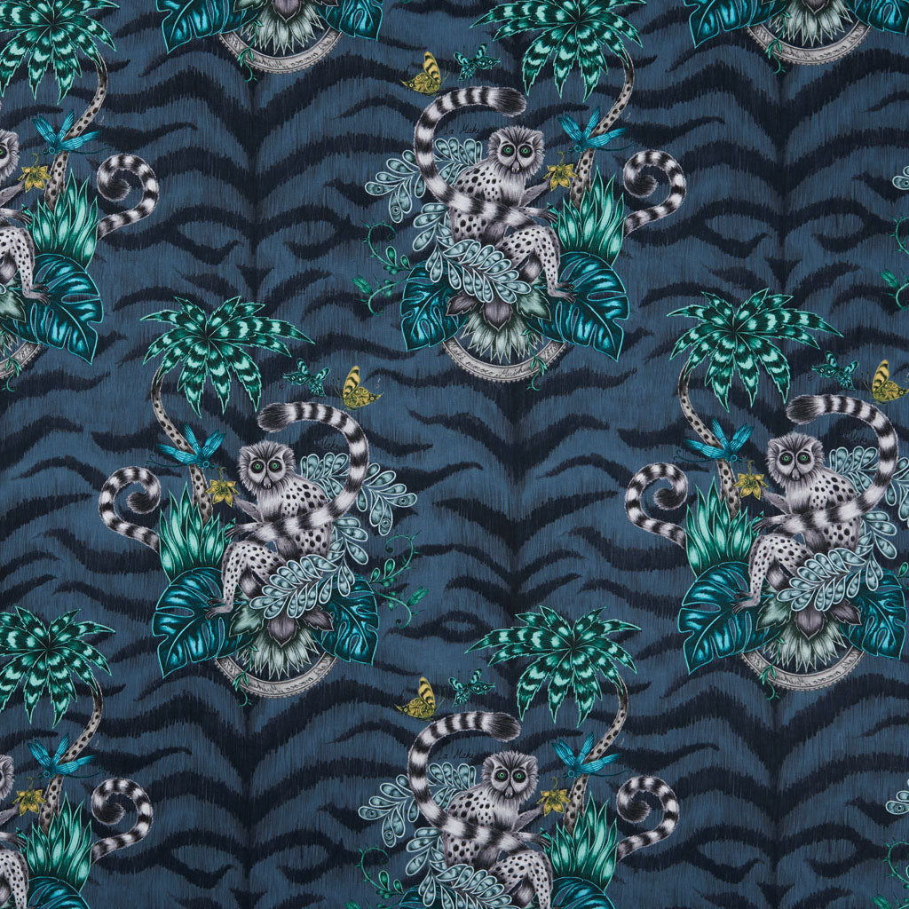 The fantastically magical navy Lemur cotton satin fabric designed by Emma J Shipley in collaboration with Clarke & Clarke featuring