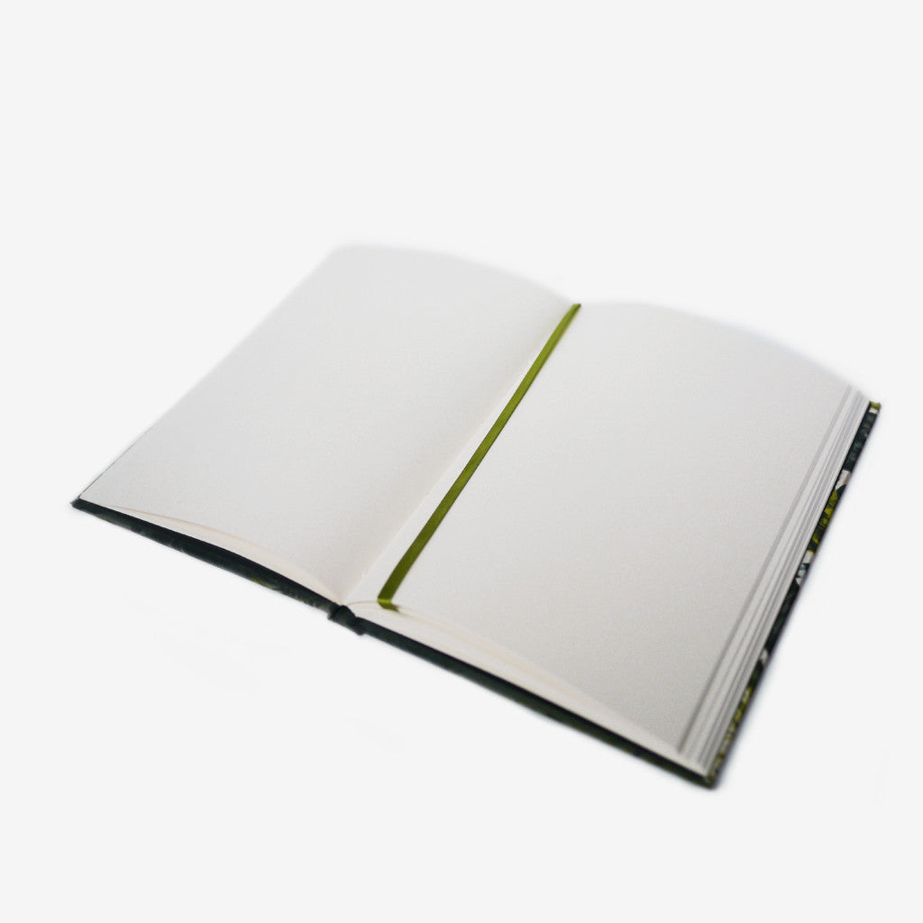 Each notebook comes with a coloured silk bookmark, filled with luxurious cream plain paper