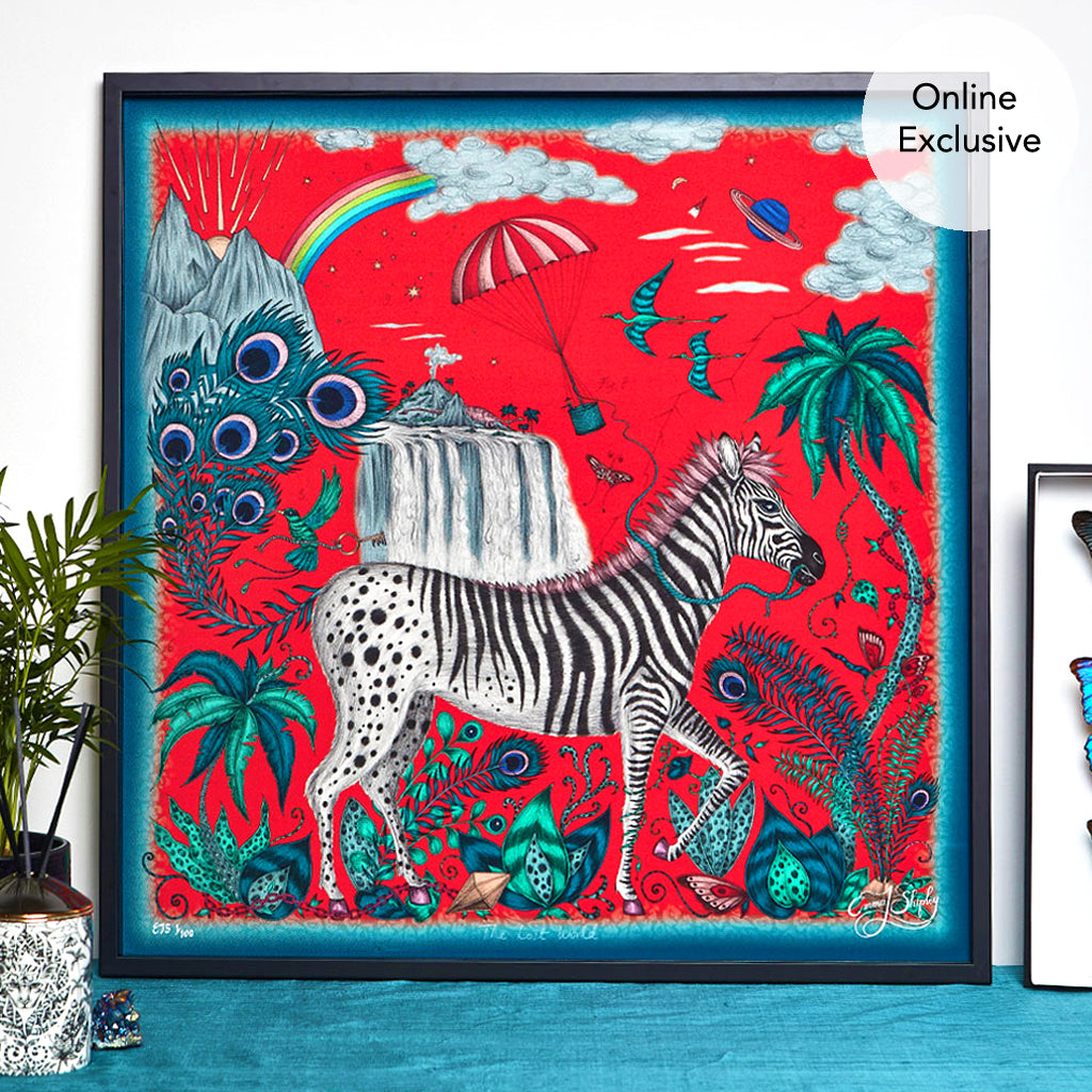 The magical Lost World Design in Red on the new silk artwork piece by Emma J Shipley. The piece features a bold Zebra, intertwining palms and a peacock feather tail