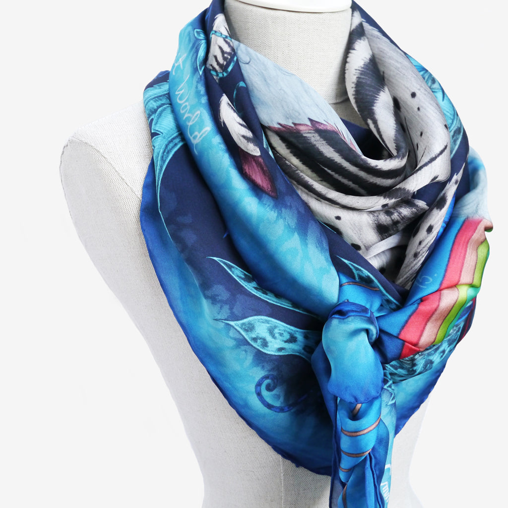 See the details of the Lost World silk chiffon scarf in Midnight from this close up example of how to wear in a classic scarf style