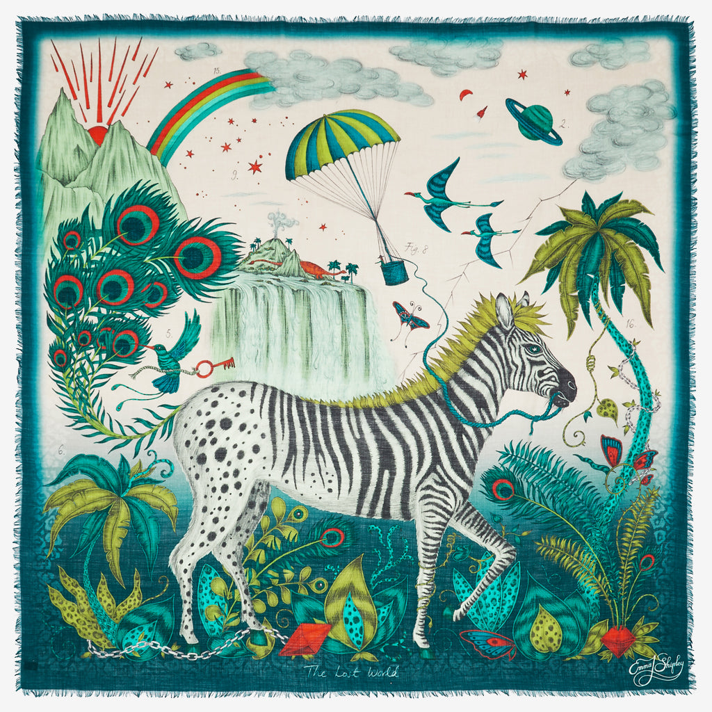 The zebra of the Lost World Fine Wool scarf explores his curious surroundings in this luxurious green, lime and teal fine Italian wool scarf designed by Emma J Shipley