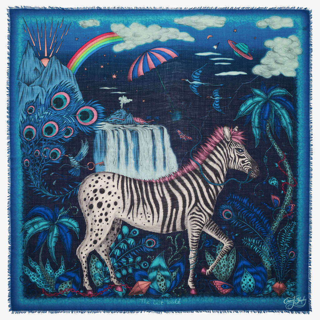 The deep navy Lost World fine wool scarf designed by Emma J Shipley features a magical zebra upon a surreal African safari scene