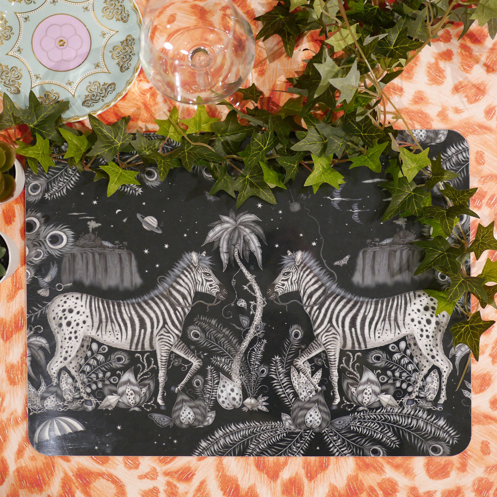 Emma J Shipley's Lost World placemat in navy monochrome colour, featuring zebras and tropical foliage