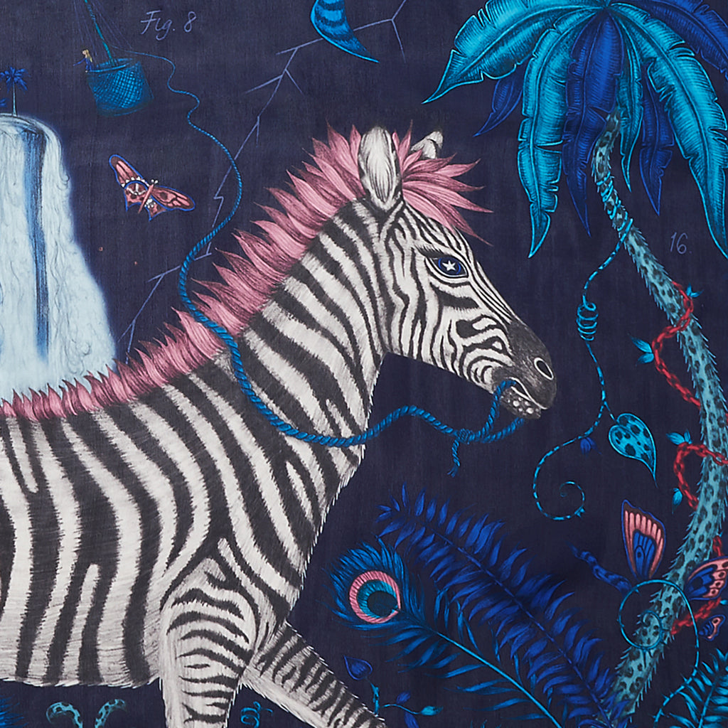 A luxury silk chiffon scarf inspired by an exotic trip through Africa, featuring zebras and magical details hand drawn by designer Emma J Shipley