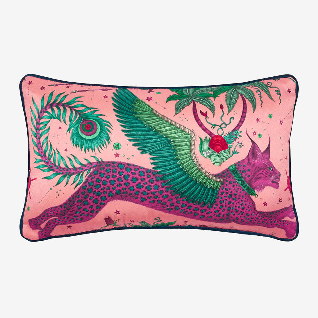 Transform your room into a Fantastical Lynx inspired dream with the Lynx Silk Double Bolster in Magenta, designed by Emma J Shipley. Featuring a striking scene of creatures including a flying Winged Lynx with peacock tails. It will work beautifully on any sofa, chair or bed.