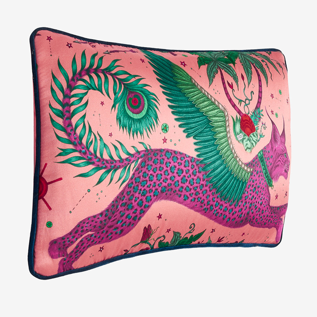 The vide view of the Lynx silk Double Bolster Cushion in Magenta it's the perfect cushion to brighten up a lounge chair or to pile up on your bed to create a magic and comforting bed spread