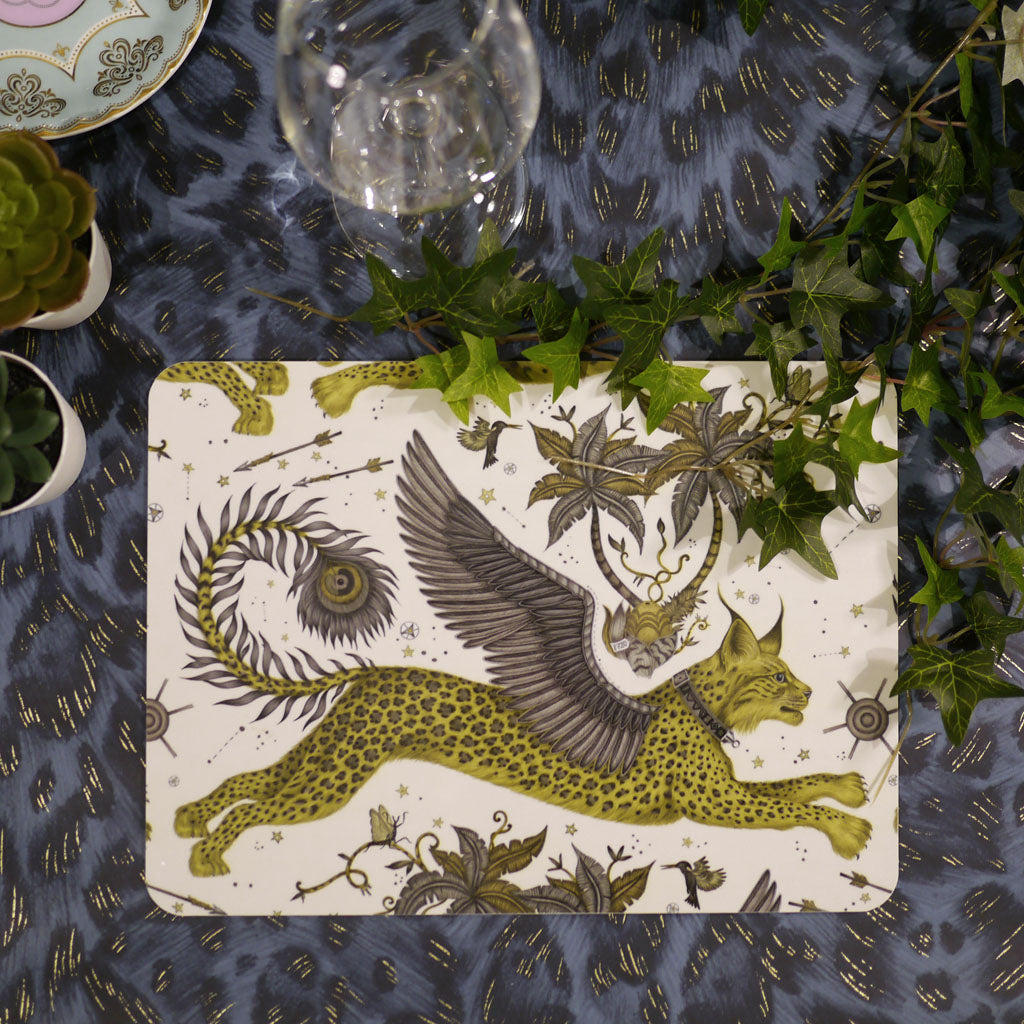 Lynx placemat by Emma J Shipley with a winged cat in golden and grey tones