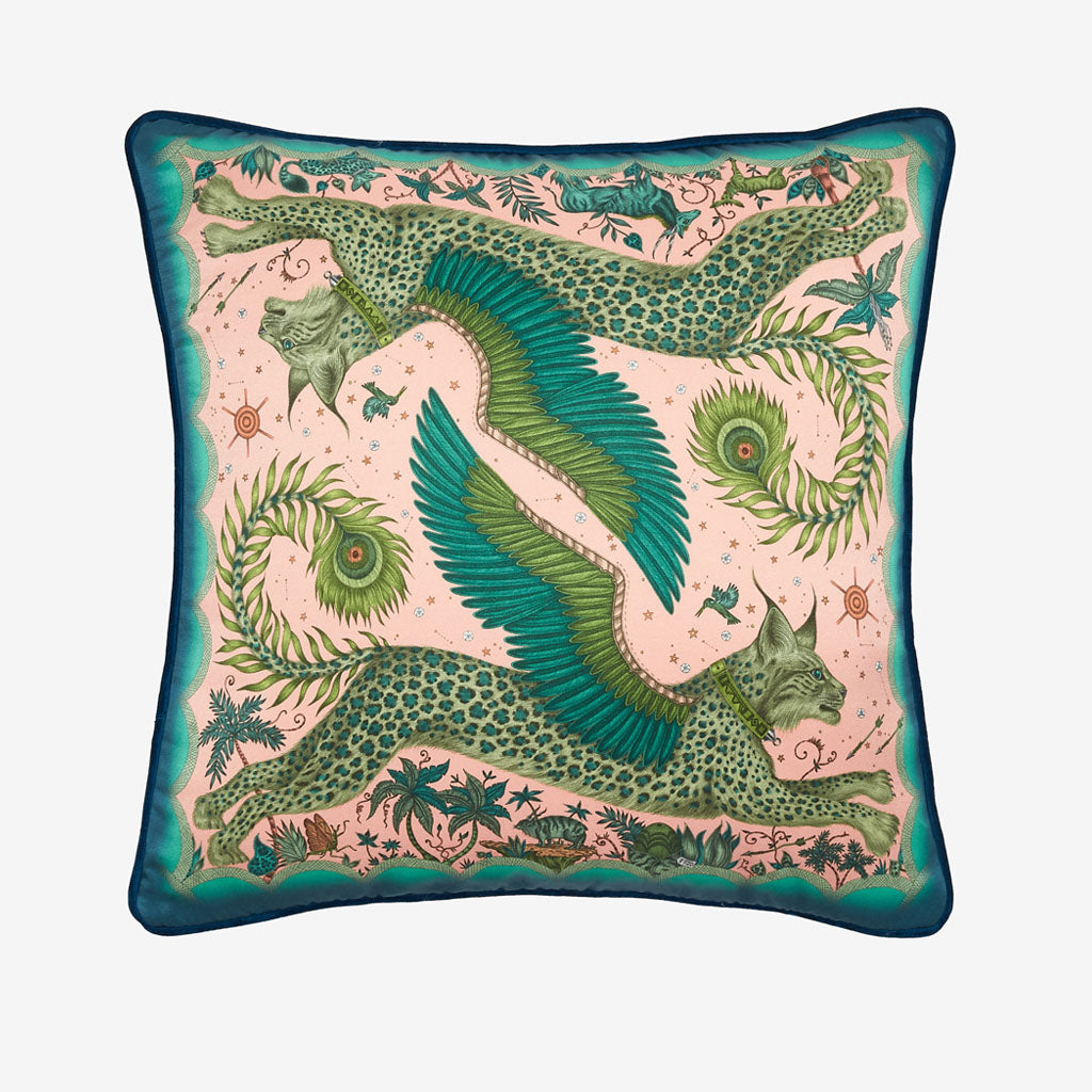 Transform your room into a Fantastical Lynx inspired dream with the Lynx Silk Cushion in Pink, designed by Emma J Shipley. Featuring a striking scene of creatures including a flying Winged Lynx with peacock tails. It will work beautifully on any sofa, chair or bed.