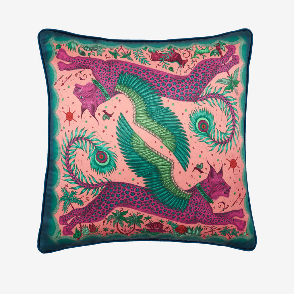 Transform your room into a Fantastical Lynx inspired dream with the Lynx Silk Cushion in Magenta, designed by Emma J Shipley. Featuring a striking scene of creatures including a flying Winged Lynx with peacock tails. It will work beautifully on any sofa, chair or bed.