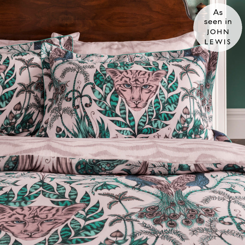 Transform your bedroom into a jungle paradise with the Amazon Oxford Pillowcase in pink, featuring an exotic scene of creatures and foliage, both real and imaginary. Inspired by a journey through the rainforest, the Amazon design is printed onto a 200 thread count cotton sateen reversible duvet cover. Created in collaboration with Clarke & Clarke and John Lewis