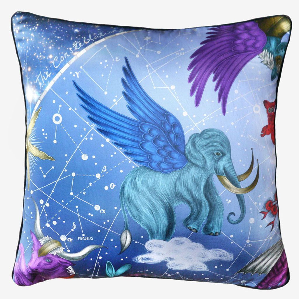 The stunning blue Constellation Large Cushion designed by Emma J Shipley features a wooly mammoth and outer space surreal delights