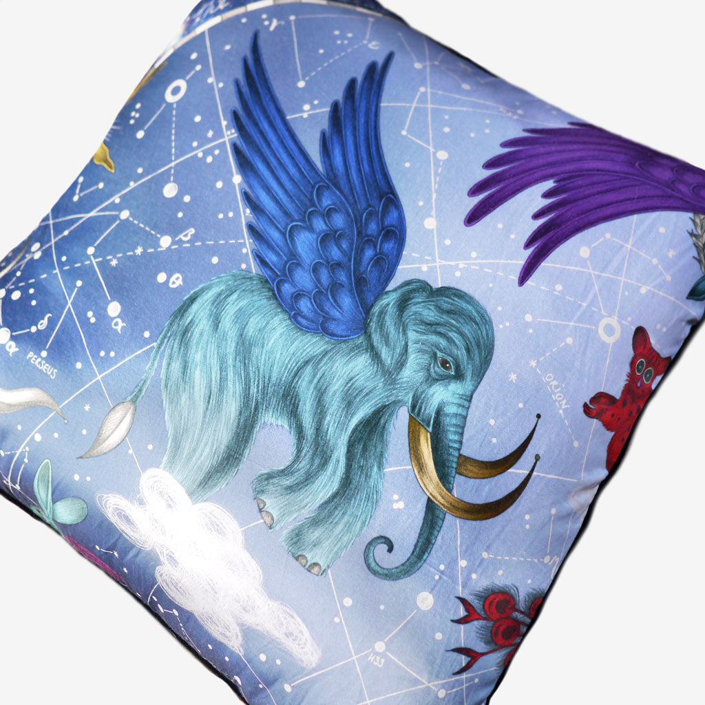 The regal winged wooly mammoth upon Emma J Shipley's stunning Constellation Cushion