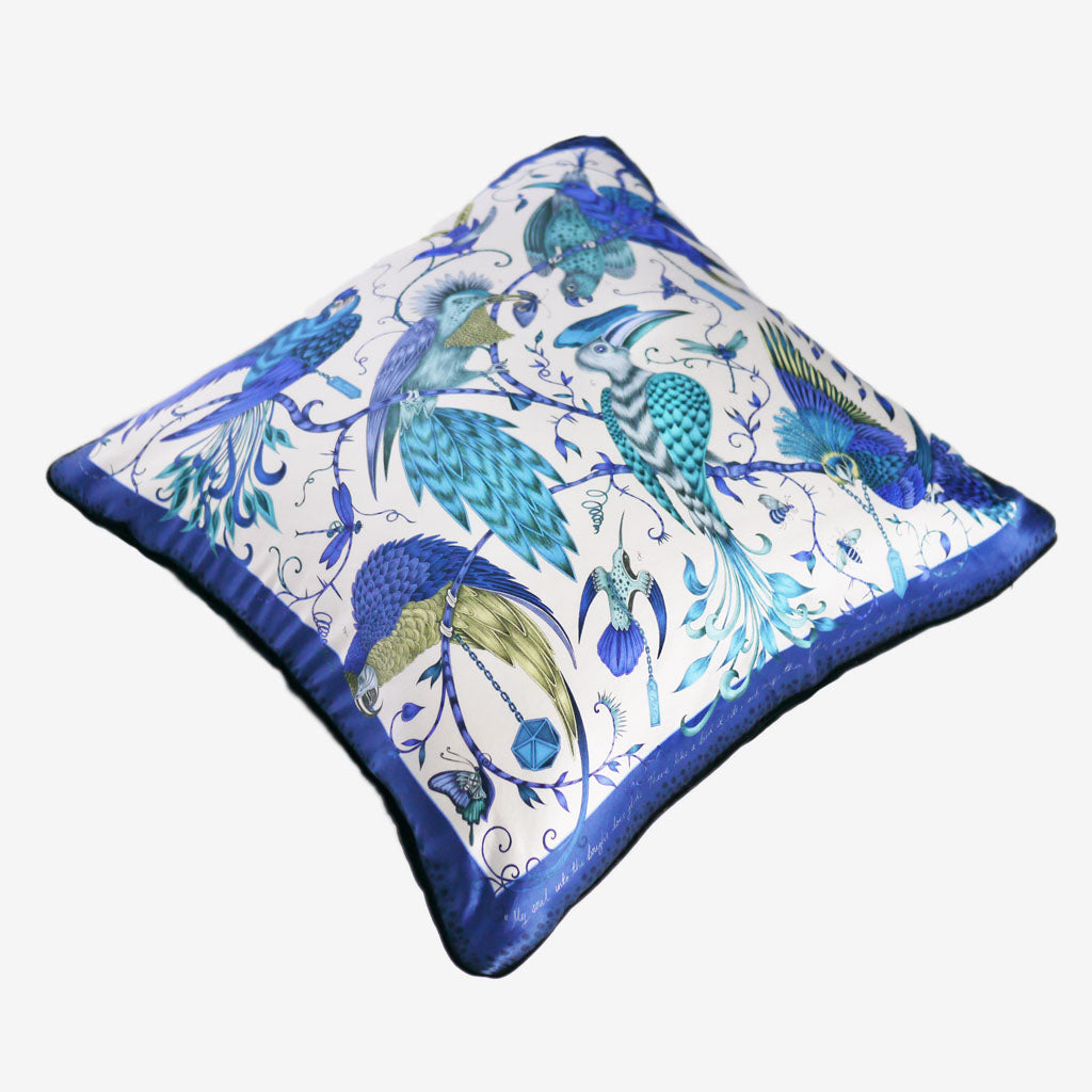 The opulent blue Audubon Large Cushion by Emma J Shipley features an array of fantastical birds inspired by John James Audubon