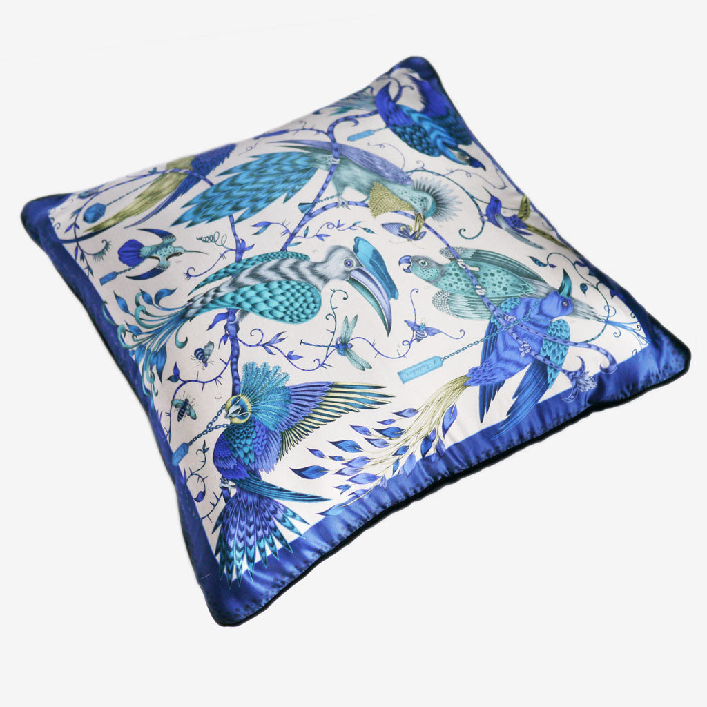 The brilliant blue Audubon Large Cushion, made with a luxurious silk and cotton blend, designed by Emma J Shipley