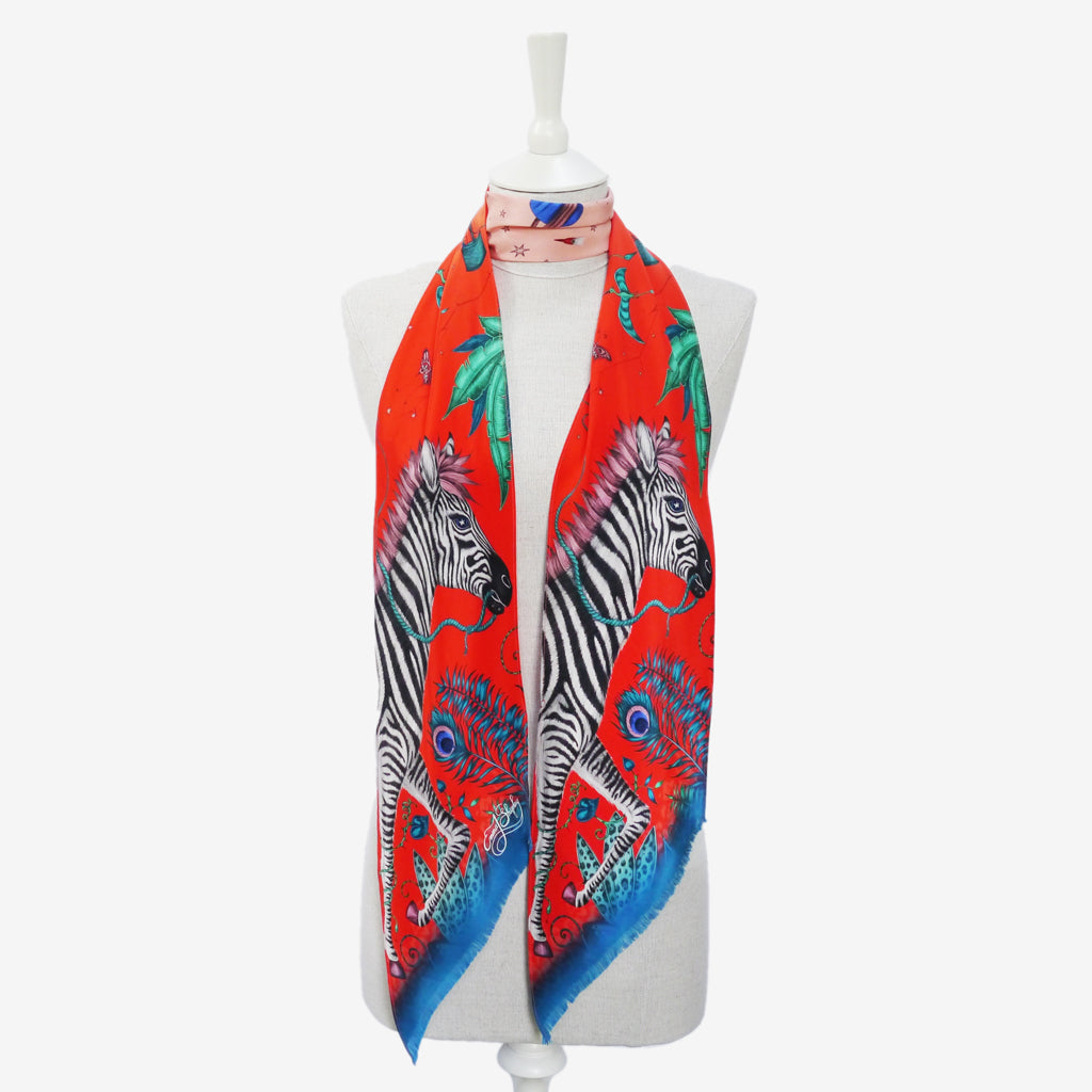 an example of how to wear the bright red Lost World silk skinny scarf hand drawn by designer Emma J Shipley