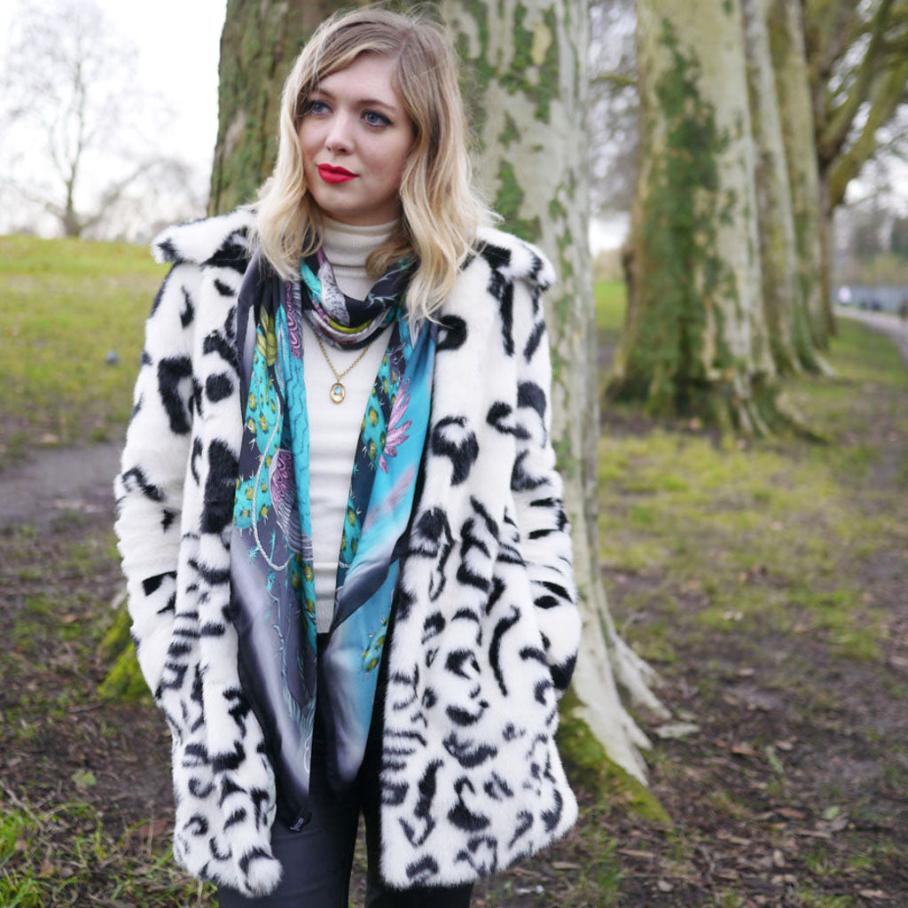 Emma J Shipley wearing her Frontier silk chiffon scarf in teal and lime colours on black