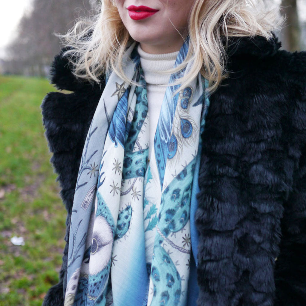 Detail of Emma J Shipley wearing the Frontier wool 140 x 140cm scarf in blue